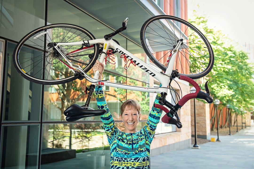 lisa hesse, wellness coach shown with bike